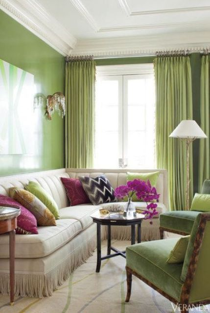glossy greenery accent wall and curtains, a couple of chairs that echo