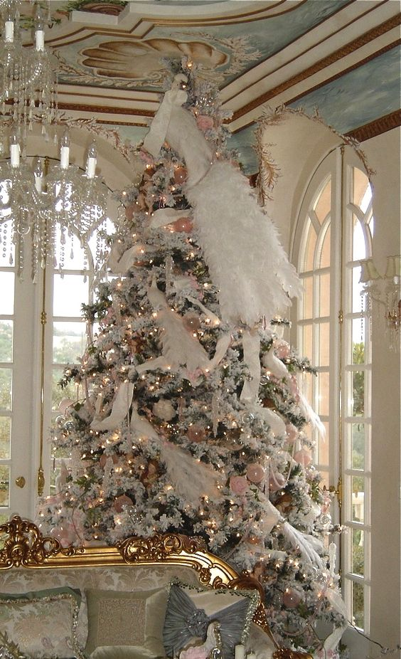 large Christmas tree decorated in white and pink, faux fur and garlands