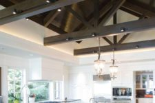 04 large kitchen with dark wooden beams and track lights