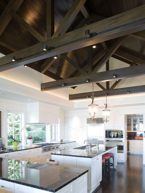 Large Kitchen With Dark Wooden Beams And Track Lights
