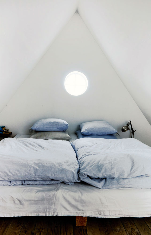 The bedroom is located on the second floor and is attic, which makes it even moder inviting