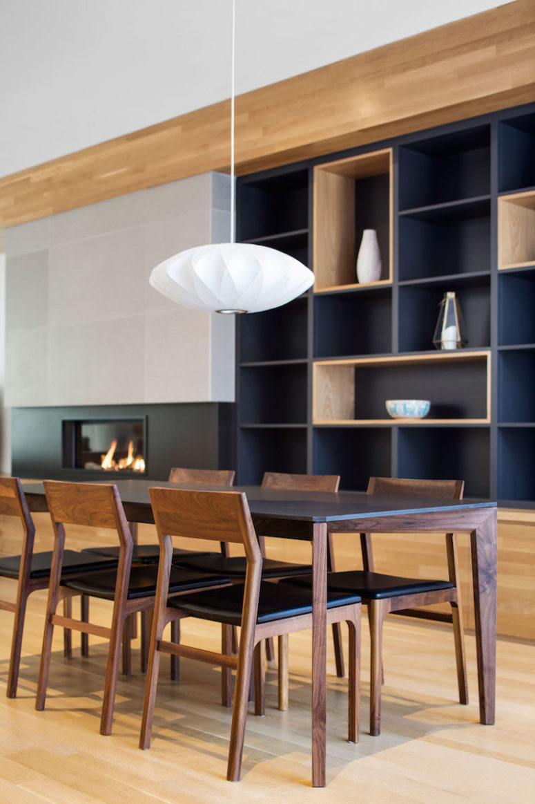 The dining table and chairs are simple and elegant, capturing the essence of the material and colors