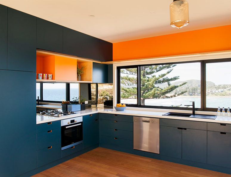 The interior is done in a mix of earthy, even orange tones and blues