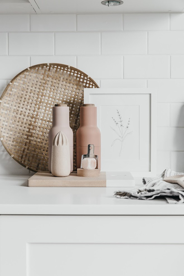 The kitchen is white but pastels can be seen here, too, dinnerware and accessories are done in pink