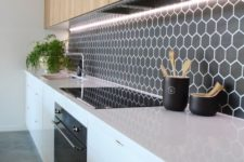 05 black hex tile backsplash with white grout contrasts with warm wood cabinets