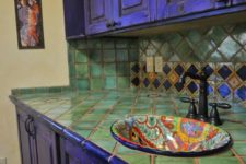 05 bold violet kitchen cabinets and green tiles on the backsplash and countertop