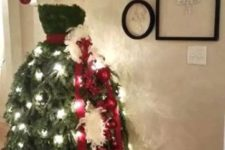 05 elegant dress Christmas tree with lights and a red sash