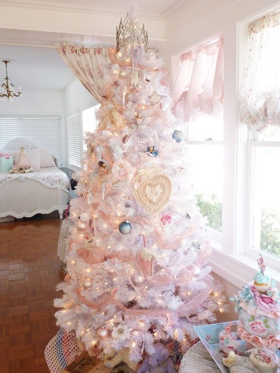 white Christmas tree with lights and pastel ornaments