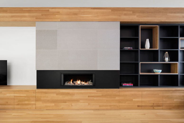 A built-in fireplace makes the decor even more welcoming, warm and comfortable