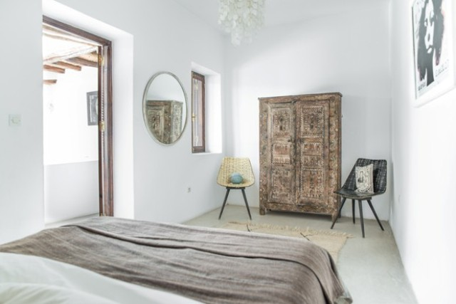 I admire an antique Moroccan wardrobe and modern chairs covered with traditional fabrics