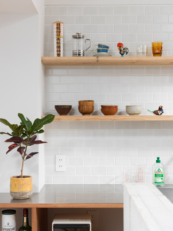 Subway tiles and warm wood shelves look elegant and stylish together