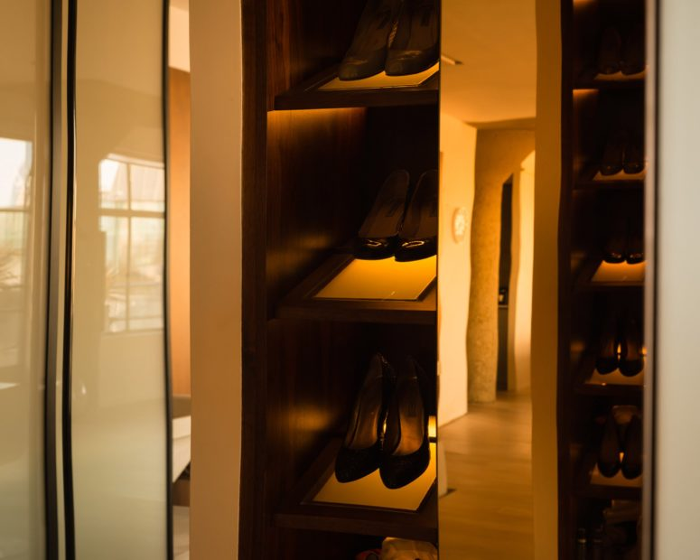 The closets are clad with American walnut