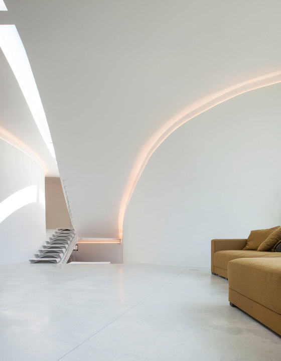 The curves are highlighted with hidden lights inside to give the house a spaceship look