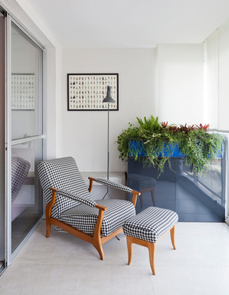 There's a comfy lounger and potted greenery in the balcony for a fresh touch
