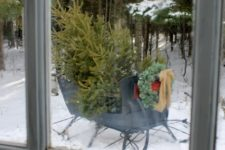 06 a tree can be left in a real sleigh, looks as if it has just beedn carried by Santa Claus