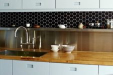 06 black hexagon tiles with white grout to make a cool statement in the kitchen