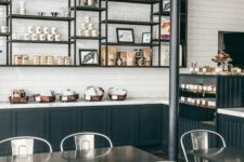 06 industrial-styled coffee shop with metal furniture and dark metal shelves