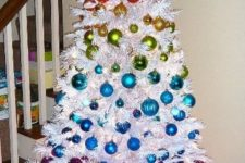 06 such colorful ornaments look amazing on a crispy white tree and stand out even more