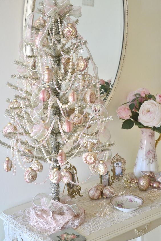 unique silver tabletop tree with white beads and pink ornaments