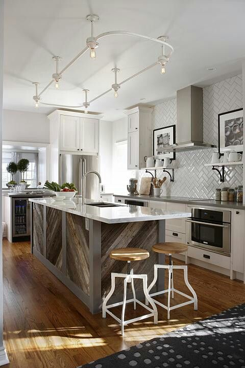 whitewashed track lights stick to the kitchen decor