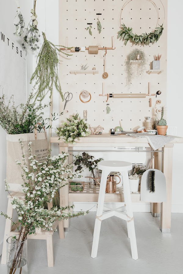 The Crafting Nook Features Beige And Blush Furniture And Lots Of Greenery  And Flowers