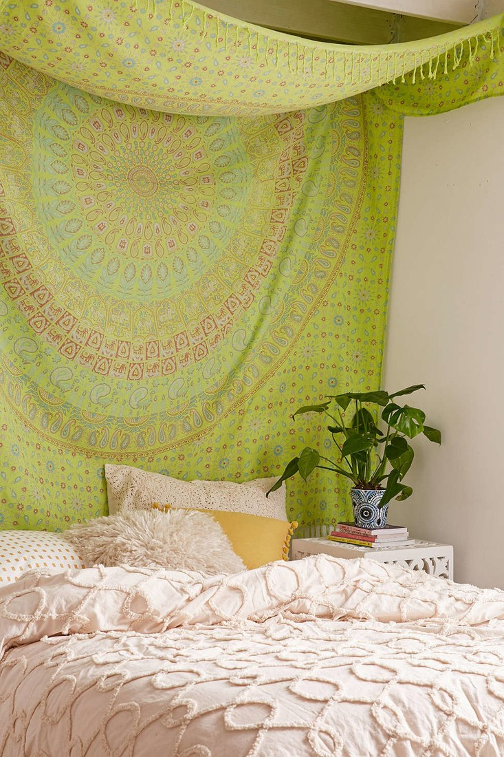ethnic blanket instead of a headboard in your bedroom