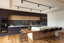 07 minimalist kitchen with track lights over the kitchen island and counter