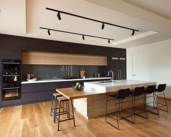 Minimalist Kitchen With Track Lights Over The Kitchen Island And Counter