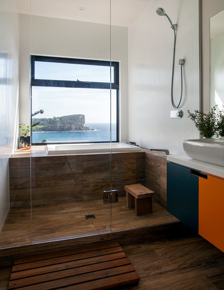 Each space gets most of the ocean views like this bathroom