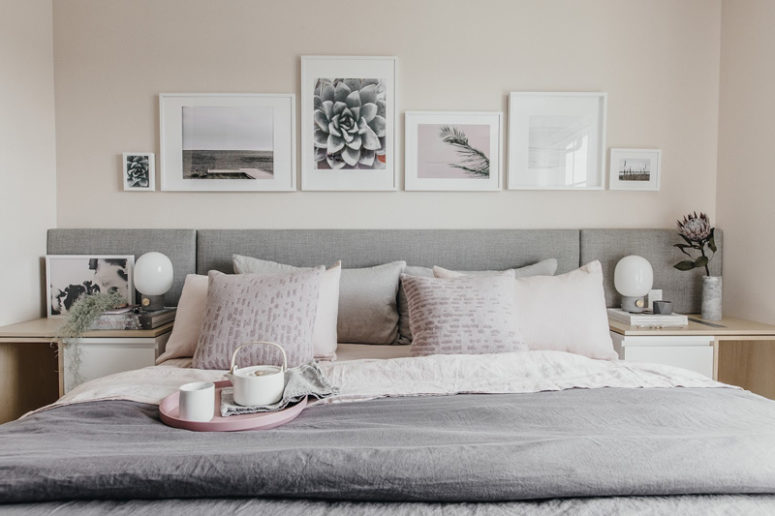 The master bedroom has an upholstered bed, comfy nightstands and monochrome artworks