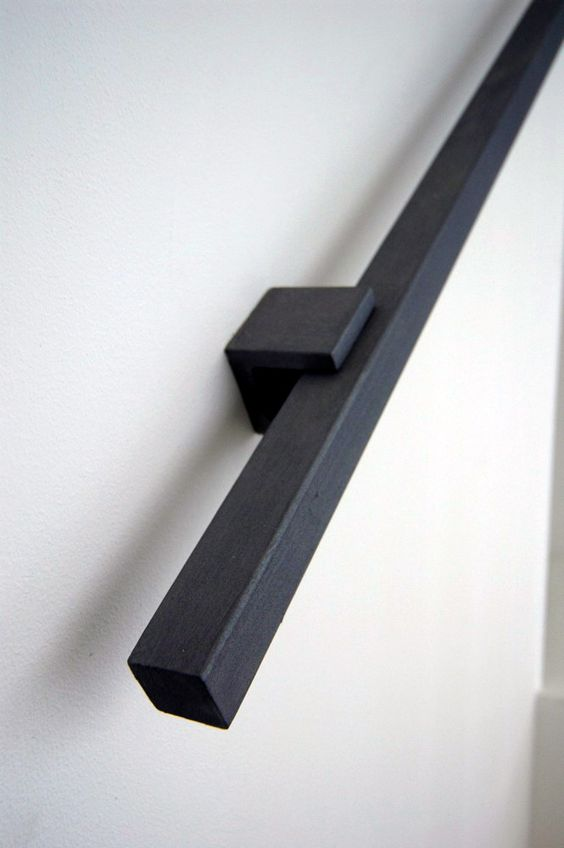 darl wooden handrail for a modern staircase
