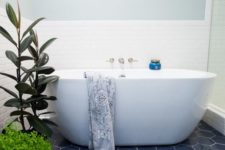 08 navy hex tiles with white grout give a seaside look to the bathroom