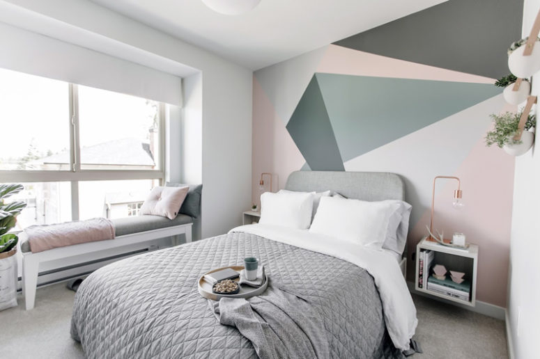Another bedroom has an accent headboard wall with geometric shapes and a cozy windowsill bed for enjoying the views