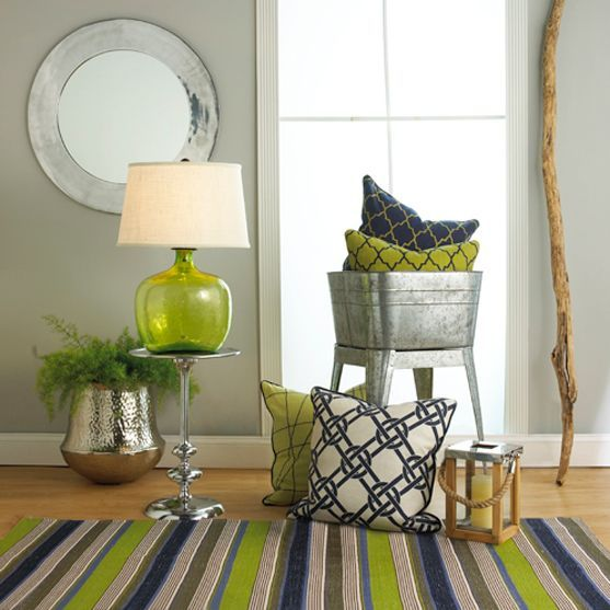 a greenery glass lamp and a striped rug with this color
