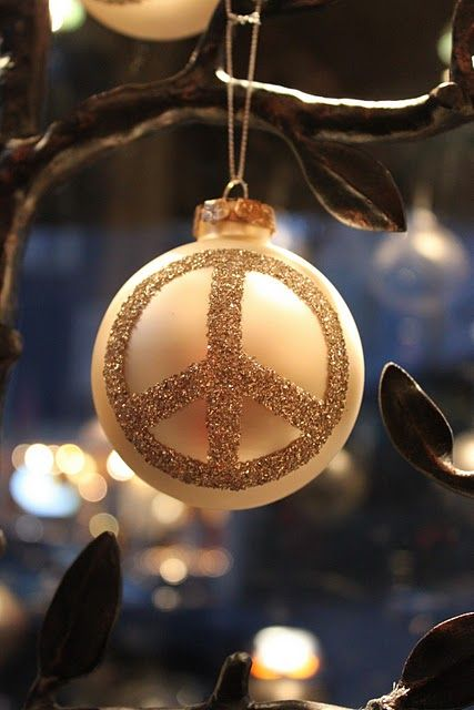 a pastel ornament with a glitter peace sign can be made by yourself