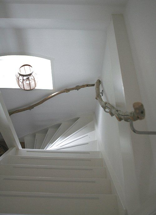 driftwood branches for handrails will give your stair a beach feel