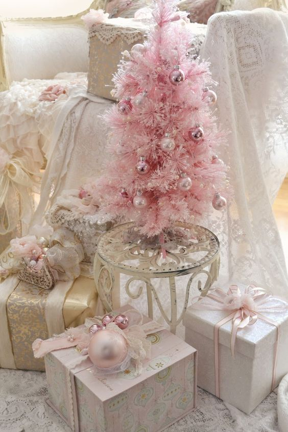 pink, blush and gold Christmas display with a tree and gifts