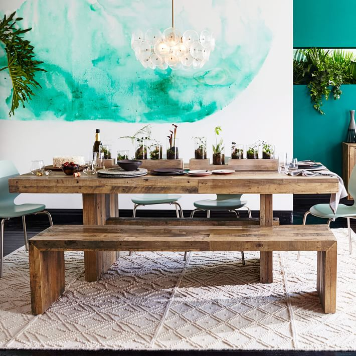 reclaimed wooden table and benches contrast with modern watercolor wall art