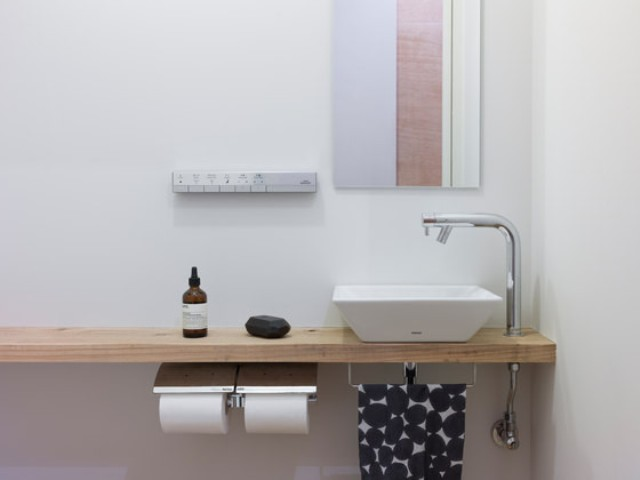 A wooden countertop and a small sink look cute together