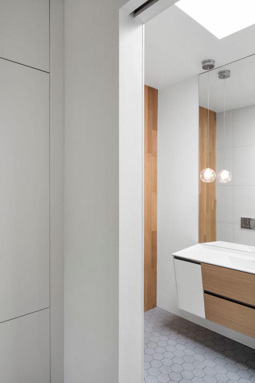 The hexagonal floor tiles add a cheerful touch to the bathroom decor