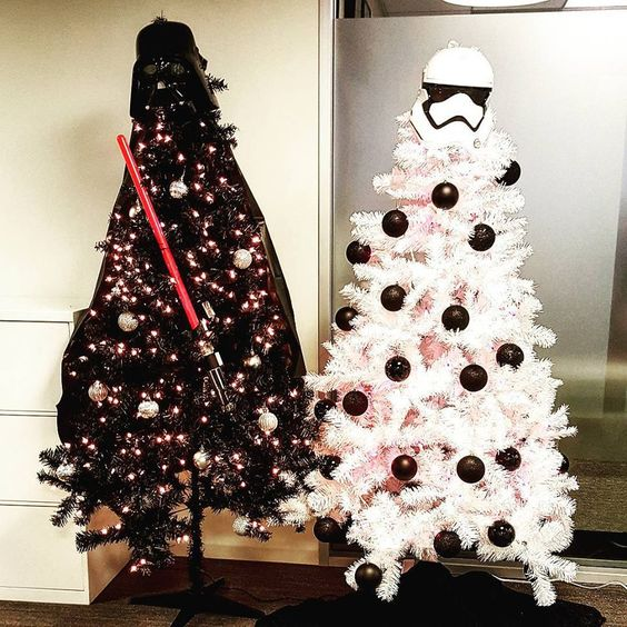 black Darth Vader tree with a lightsaber and a white Storm Trooper tree with black ornaments