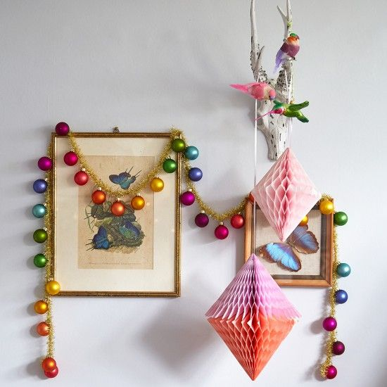 colorful Christmas ornament garland and paper decorations