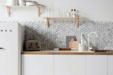 10 grey hex tile backsplash contrasts with white cabinets