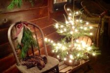 10 lit up christmas tree on a wooden sleigh