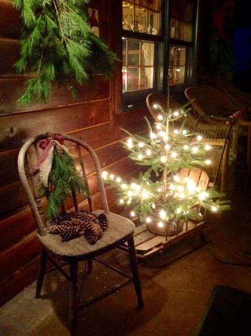 lit up christmas tree on a wooden sleigh