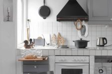 10 retro Scandinavian kitchen with white tiles and grey grout