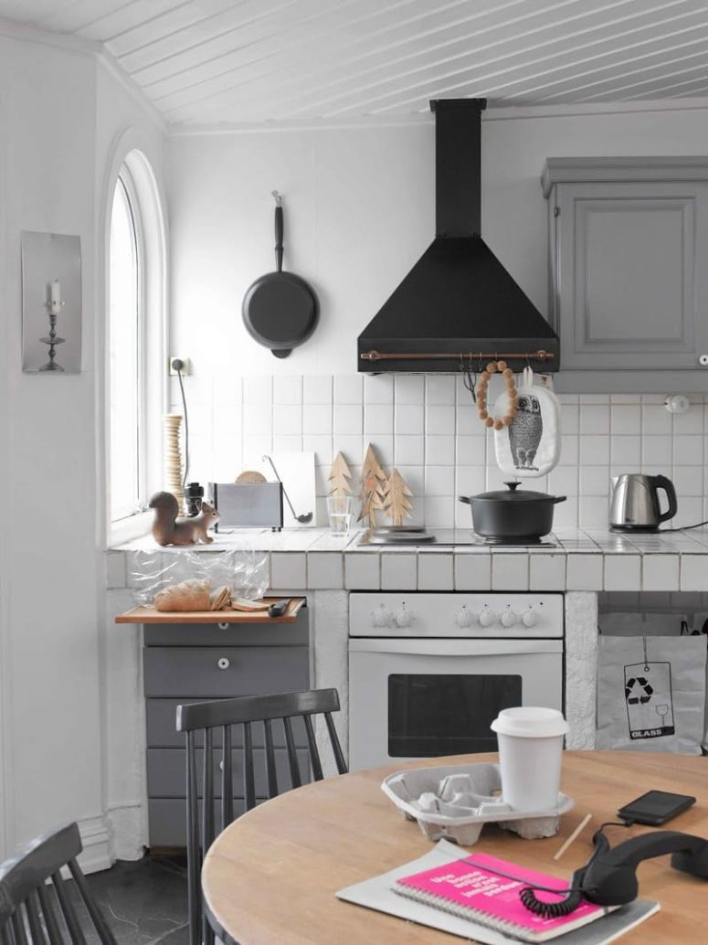 retro Scandinavian kitchen with white tiles and grey grout