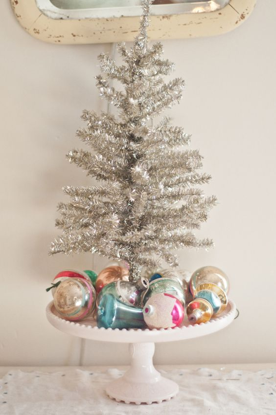 cake stand with ornaments and a small silver tree