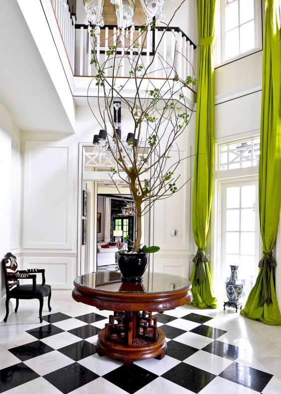 highlight your double height windows with lime green curtains