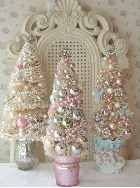 pastel and metallic christmas trees all decorated with beads and small ornaments